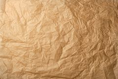 skrynkligt brunt stekhett pergamentpapper royaltyfria bilder