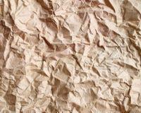 Skrynkligt gammalt brunt papper Arkivfoton
