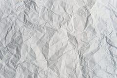 skrynkligt grått ljust papper Arkivfoto