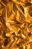 Skrynkligt guldpapper Arkivbilder
