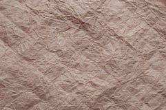 skrynkligt kraft papper Textur skrynklade ?teranv?nt brunt papper arkivbild