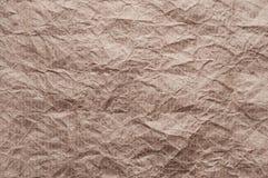 skrynkligt kraft papper Textur skrynklade ?teranv?nt brunt papper fotografering för bildbyråer