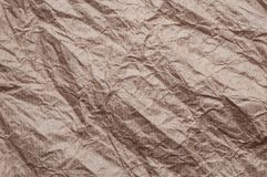 skrynkligt kraft papper Textur skrynklade ?teranv?nt gammalt brunt papper royaltyfria foton