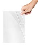 Skrynkligt papper för hand som hållande vit isoleras på vit Arkivfoto