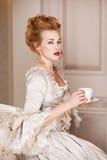 Sköt inomhus i den Marie Antoinette stilen Arkivfoto