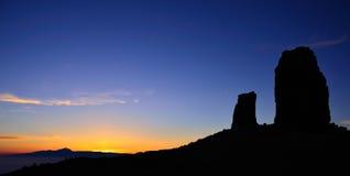 Skugga av Roque Nublo på solnedgången, Gran canaria Fotografering för Bildbyråer