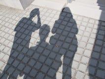 Skugga av tre personer arkivfoton