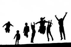 Skuggafolk som spelar och hoppar royaltyfri bild
