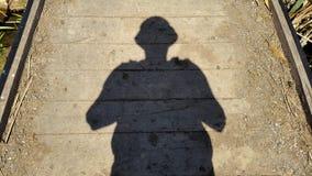 skuggan av en man på ett trägolv Royaltyfria Foton