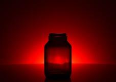 Skuggar glasflaskan Fotografering för Bildbyråer