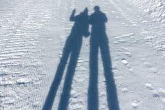 Skuggar på snowen Arkivfoton