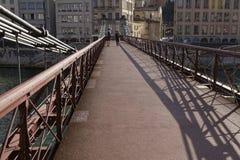 Skuggor på den fot- bron Fotografering för Bildbyråer