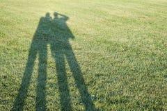 Skuggor på gräs Royaltyfri Fotografi