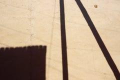 Skuggor på leraväggen abstrakt bakgrund Arkivfoto