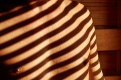 Skuggor på manbröstkorg Royaltyfri Foto