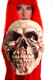 Skull. Young woman wearing a red wig holding a skull Royalty Free Stock Photography