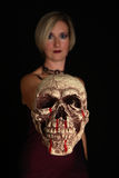 Skull. Young woman holding a skull Stock Image