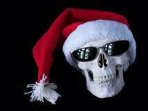 Skull 2. Human skull wearing a christmas hat and sunglasses Royalty Free Stock Image