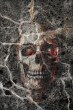 The skull. Background digiart - a dead person's skull in a wall Stock Photography