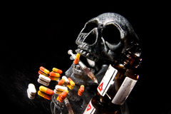 Skull. And Pills on Black Background Royalty Free Stock Images