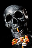 Skull. And Pills on Black Background Stock Photo