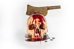 Skull abused with knife blood flow, still life Royalty Free Stock Image