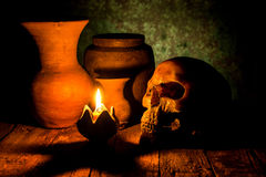 Skull And Candle With Candlestick On Wooden Royalty Free Stock Images