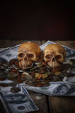 Skull on bank note and coin, money Stock Photography