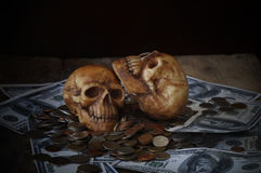 Skull on bank note and coin, money Stock Photos