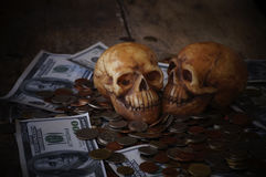 Skull on bank note and coin, money Royalty Free Stock Photo