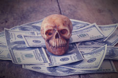 Skull on bank note and coin Royalty Free Stock Photo