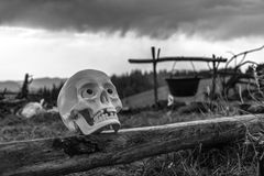 Skull on the bench against the backdrop of the mountains. bw. Royalty Free Stock Photos