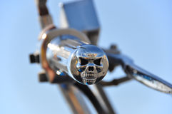 Skull bike grip. Chrome skull motorcycle handle grip. Symbol of death, mortality and evil royalty free stock images