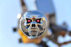 Skull bike grip. Chrome skull motorcycle handle grip. Symbol of death, mortality and evil stock photography