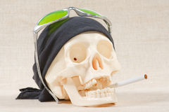 The skull with black bandana and cigarette Stock Photos
