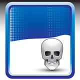 Skull on blue halftone background Stock Photo