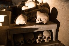 Skull and bones. In ancient ossuary, Naples royalty free stock images