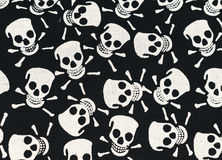 Skull and Bones. Gothic design, scenery for Halloween. Color print on cotton fabric. White skulls and bones on a black background Stock Photo