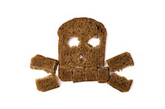Skull and bones made of sliced bread. Isolated on white background stock photo