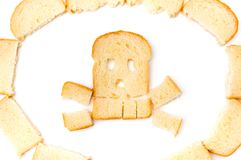 Skull and bones made of sliced bread. On white background royalty free stock photo