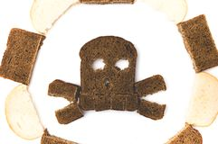 Skull and bones made of sliced bread. On white background stock images
