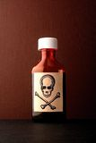 Skull and bones poison bottle stock photography