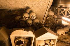 Skull and bones. In ancient ossuary, Naples stock photo