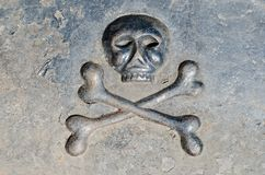 Skull with bones on the tombstone.  stock photos