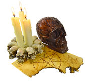 Skull with burning candles Stock Photos