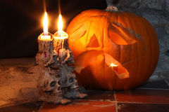 Skull Candlesticks & Pumpkin Lantern Stock Photography