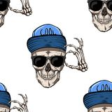 Skull in the cap. Sunglasses. He welcomes everyone. Seamless pattern Stock Images