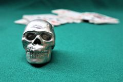 The skull with on the cards stock photo