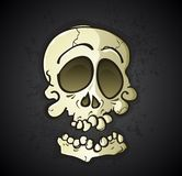 Skull Cartoon Character. An old dry skull cartoon character with a disjoined bottom jaw and a stylized unrealistic look Royalty Free Stock Images