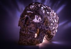 Skull with carved pattern on blue gradient. Background with lights Royalty Free Stock Photos